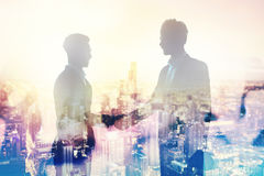 Handshake of two businessperson in office concept of partnership and teamwork. Handshake of two businessperson in a modern office. concept of partnership and Royalty Free Stock Photos