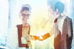 Handshake of two businessperson in office concept of partnership and teamwork.double exposure Royalty Free Stock Photography