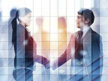 Handshake of two businessperson in office concept of partnership and teamwork.double exposure royalty free stock images