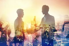 Handshake of two businessperson in office concept of partnership and teamwork. Handshake of two businessperson in a modern office. concept of partnership and Stock Images