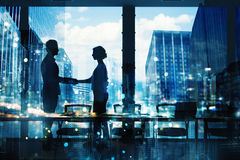 Handshake of two businessperson in office concept of partnership and teamwork Stock Photos
