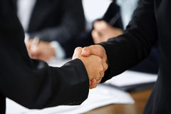 Handshake between two businesswoman Stock Image