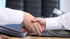 Handshake between a two children on office background. Handshake between a two children isolated on office background stock footage