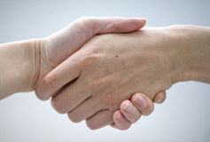 Handshake two hands with blur background Stock Photo