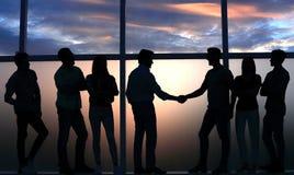 Handshake two like-minded near a large window. royalty free stock photos