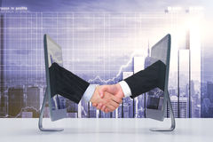 Handshake of two monitors via the Internet. Business concept Royalty Free Stock Images