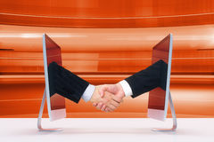 Handshake of two monitors via the Internet. Close up Stock Photos
