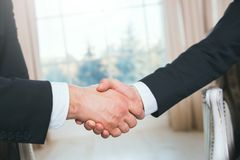 Handshake of two people, businessmen on a light background. Handshake of two people, businessmen on a light background Stock Photos