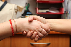 Handshake between two person. In the office Stock Image