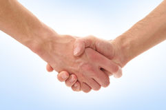 Handshake of two persons on a blue background Stock Photography