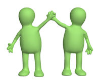 Handshake of two puppets Royalty Free Stock Image