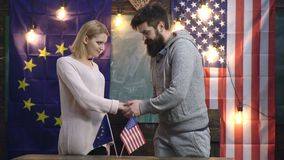 Handshake of two states. Usa and europe friendship. Conceptual deal between USA and UE. United States and EU handshake. International friendship, flag stock footage