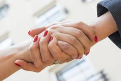 Handshake of two women Stock Images
