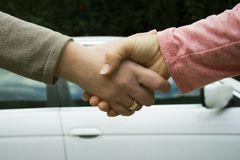 Handshake of two women Stock Image