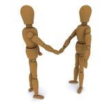 Handshake of two wooden dolls Stock Photo