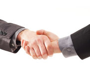 A handshake between two young businessmen Stock Photos