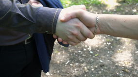Handshake of two young men in the woods stock video footage