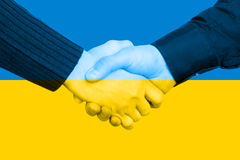 Handshake and Ukrainian Flag Stock Photos
