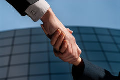 Handshake unrecognizable business man and woman. On modern building background Royalty Free Stock Photos