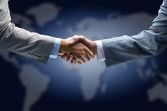 Handshake With Map Stock Photo