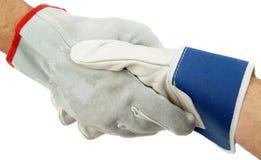 Handshake. Good Job. Handshake, working gloves and protect Royalty Free Stock Photography