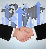 Handshake and world map Stock Images