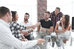 Handshake of young employees royalty free stock photography