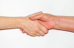 Handshake of a young girl and her grandmother. Ukraine Stock Photography
