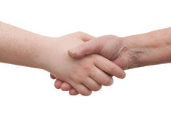 Handshake - between young and old  females Royalty Free Stock Photo