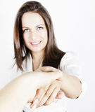 Handshake. Young, smiling business woman in a handshake Royalty Free Stock Image