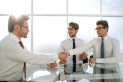 Handshakes of business people in a modern office. Business concept royalty free stock images
