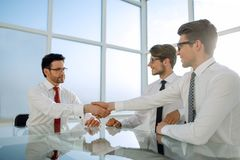 Handshakes of business people over the Desk in a bright office. Handshake business people over the Desk in a bright office.photo with copy space royalty free stock images