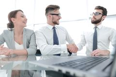 Handshakes colleagues at the Desk. Concept of partnership royalty free stock photography