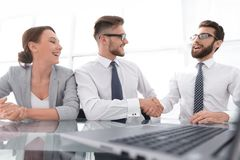 Handshakes colleagues at the Desk. Concept of partnership stock photos