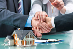 Handshakes with customer after contract signature. Estate agent shaking hands with customer after contract signature stock photos