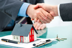 Handshakes with customer after contract signature. Estate agent shaking hands with customer after contract signature Stock Photo
