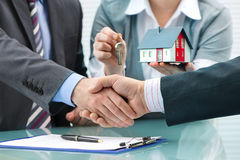 Handshakes with customer after contract signature. Estate agent shaking hands with customer after contract signature Royalty Free Stock Photos