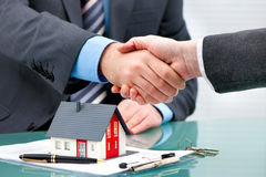 Handshakes with customer after contract signature. Estate agent shaking hands with customer after contract signature royalty free stock photo