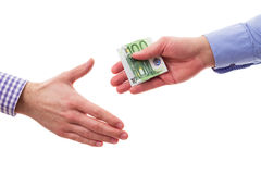 Handshakes with money. Businessman bribing other businessman with euro money stock images