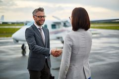 Handshaking in airport Royalty Free Stock Photos