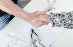 Handshaking between architect and his client Stock Images