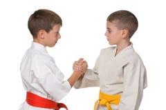 Handshaking boys in kimono Stock Images
