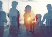 Handshaking business person in office. concept of teamwork and partnership. double exposure Royalty Free Stock Images