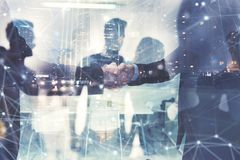 Handshaking business person in office. concept of teamwork and partnership. double exposure royalty free stock image