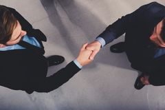 Handshaking business person in office. concept of teamwork and partnership stock photo