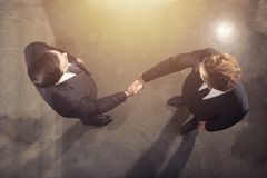 Handshaking business person in office. concept of teamwork and partnership. Handshaking business person in the office. concept of teamwork and business royalty free stock images