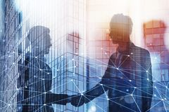 Handshaking business person in office with network effect. concept of teamwork and partnership. double exposure Royalty Free Stock Images
