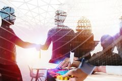 Silhouette of young workers shaking hands in the office. concept of teamwork and partnership. double exposure royalty free stock photos