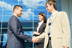 Handshaking in front of a modern building stock photos