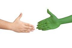 Handshaking human alien hands isolated